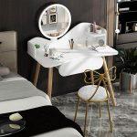 tocador diseño moderno con espejo redondo y luces led